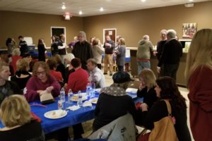 Wide shot of volunteers celebrating at the 2019 Holiday Party